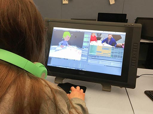 Photo of K. CAD student working on the game's 3D animation.